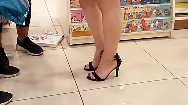 Her sexy feets red toes in open high heels