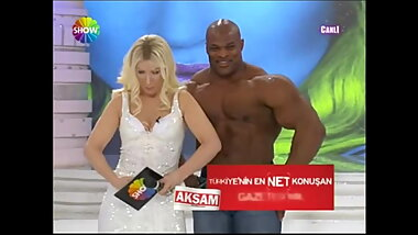 Sexy Blonde Turkish anchor with Big Man on TV Show